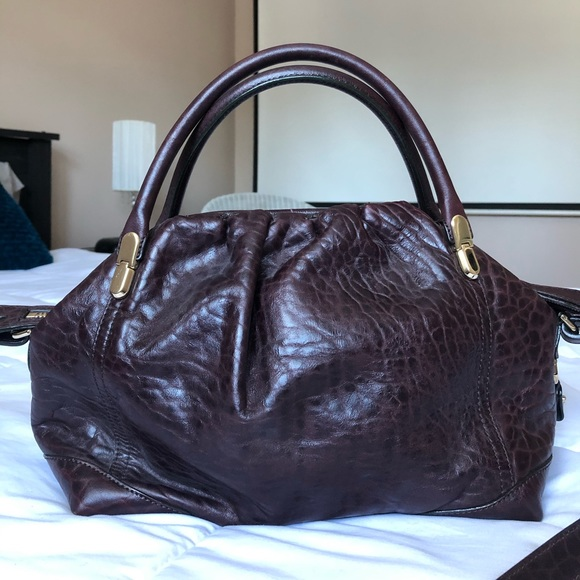 Nina Ricci - Burgundy leather bag.